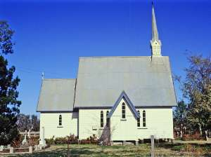 All Saints Anglican Church and cemetery Yandilla, from W (1992); Heritage Branch